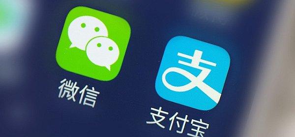 阿里巴巴与腾讯:中国互联网巨头之争将走向世界
